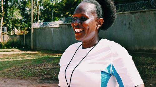 Coach Agnes smiling